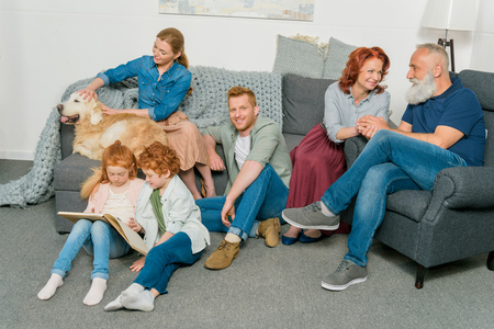 big family with dog spending time together at home Stockfoto
