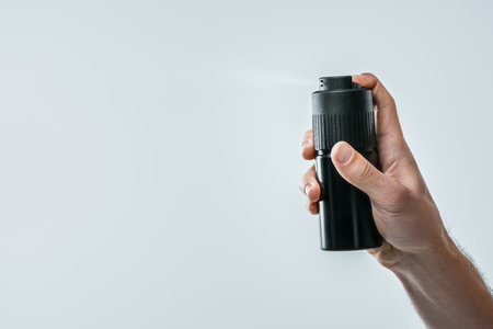 cropped view of man spraying deodorant, isolated on grey with copy space Standard-Bild