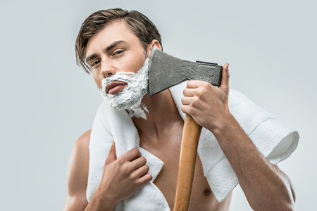 handsome man in foam shaving with ax, isolated on white 스톡 콘텐츠