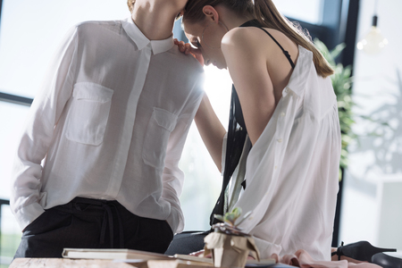 young fashionable lesbian couple at office Stock Photo