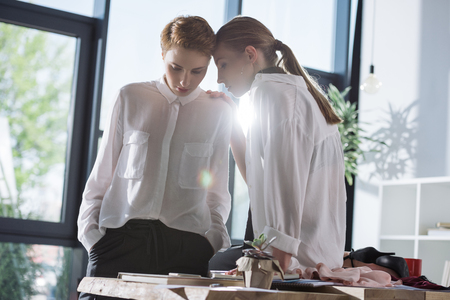 young fashionable lesbian couple at workplace in office Stock Photo