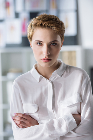 close-up portrait of stylish young woman in white shirt Banco de Imagens