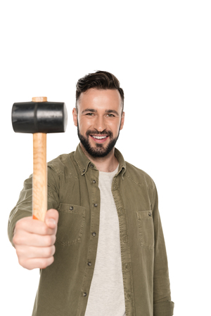 portrait of smiling man showing hammer in hand and looking at camera isolated on white