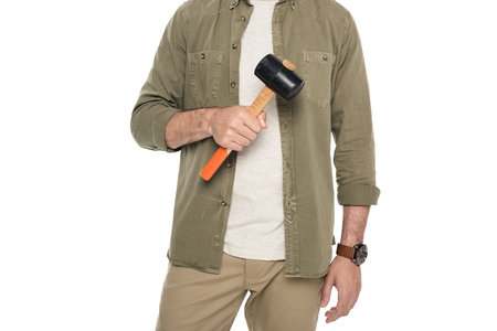 cropped shot of man holding hammer in hand isolated on white