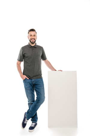 cheerful man with blank banner looking at camera isolated on white Banque d'images - 102506592