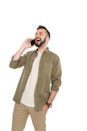 portrait of laughing man talking on smartphone isolated on white Stock Photo