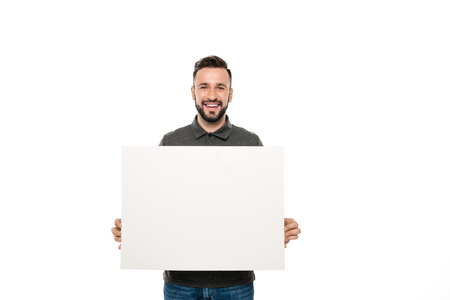 portrait of smiling man holding blank banner in hands isolated on white Zdjęcie Seryjne