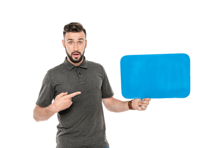 portrait of shocked man pointing at blank speech bubble in hand isolated on white Reklamní fotografie