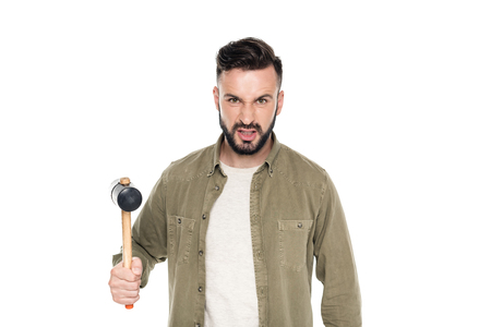 portrait of angry man with hammer in hand looking at camera isolated on white