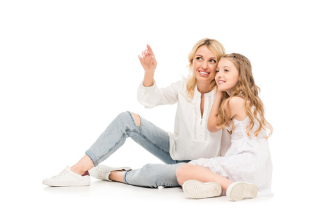 smiling daughter hugging mother isolated on white