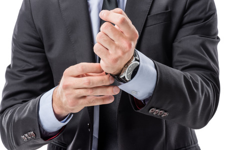 cropped shot of businessman in formal wear buttoning watch Stock Photo
