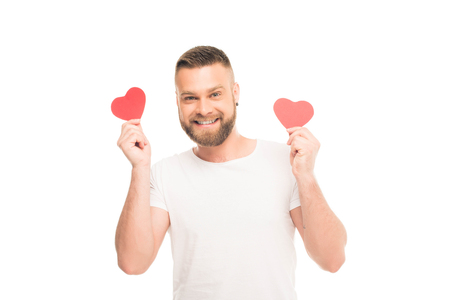 Portrait of handsome bearded man with red paper hearts, isolated on white 스톡 콘텐츠