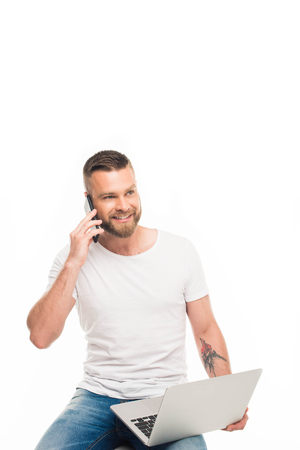 portrait of young attractive man using smartphone, isolated on white