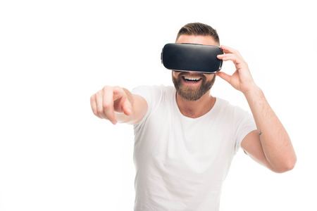 Portrait of handsome bearded man using virtual reality headset, isolated on white