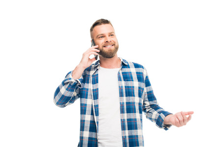 Bearded man in checkered blue shirt talking on phone, isolated on white  写真素材