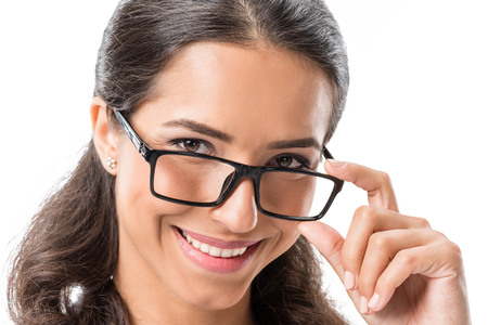 portrait of young smiling businesswoman in eyeglasses looking at camera isolated on white