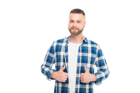 Bearded man in blue checkered shirt standing with thumbs up, isolated on white 스톡 콘텐츠
