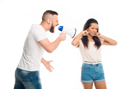man screaming on woman with help of megaphone, isolated on white