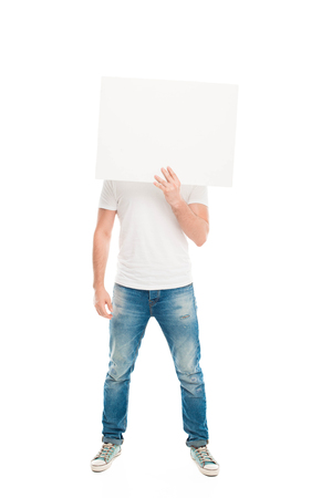 Handsome man hiding face by blank banner, isolated on white