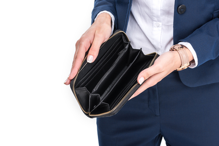 cropped view of businesswoman holding empty wallet, isolated on white  Stockfoto