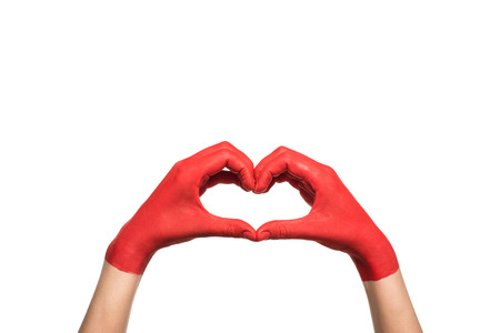 cropped view of hands in red paint showing heart sign, isolated on white Foto de archivo - 102278800