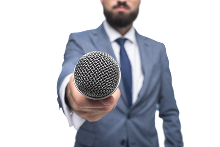 selective focus of anchorman taking interview with microphone