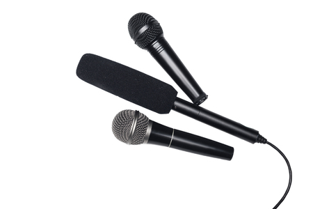 Three different black microphones isolated on white Stock Photo