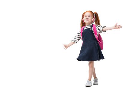 beautiful happy redhead schoolgirl listening music in headphones isolated on white
