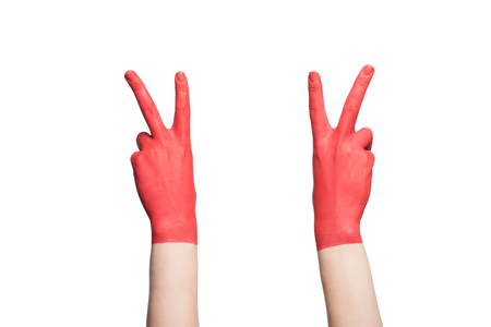 cropped view of hands in red paint showing victory signs, isolated on white Foto de archivo - 102377528