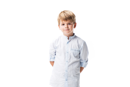 portrait of adorable little boy looking at camera isolated on white