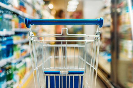 close up view of empty shopping cart in supermarket