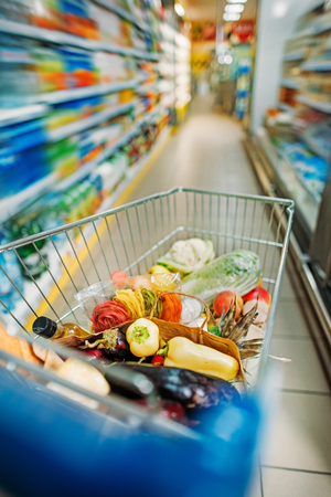 selective focus of shopping cart with purchases in supermarket Stock fotó - 102358554