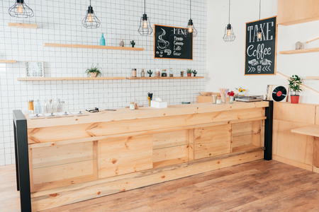 wooden bar counter of modern cafe decorated with white tiles Stock Photo
