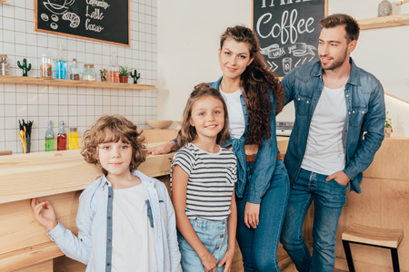 beautiful happy young family in cafe at bar counter