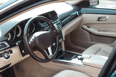 Front seats and wheel of a passenger car Фото со стока - 102256111