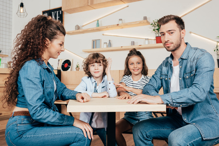 beautiful young family in cafe waiting for order Stock Photo