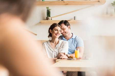 smiling young couple dating in cafe Imagens