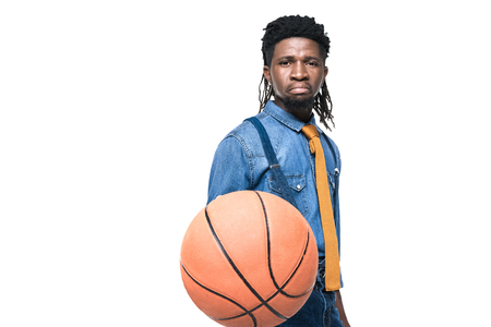 dissatisfied african american man holding basketball ball isolated on white Stok Fotoğraf