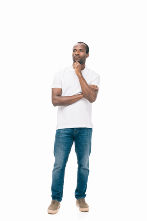 pensive african american man holding hand on chin and looking away isolated on white
