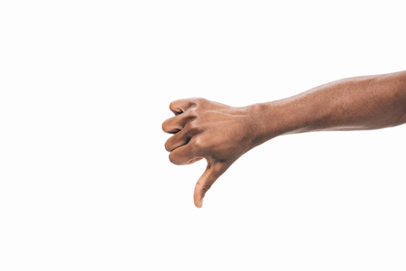 cropped shot of human hand showing  thumb down isolated on white Foto de archivo - 102256564