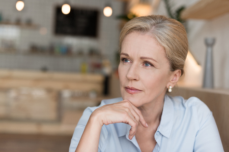 portrait of beautiful pensive mature woman looking away