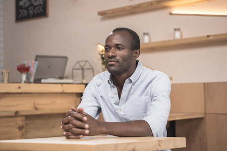 african-american man waiting for order in cafe