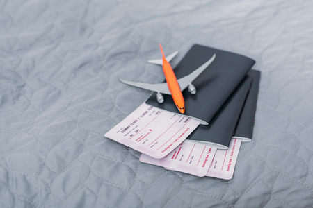 composition of flight tickets with toy airplane Archivio Fotografico