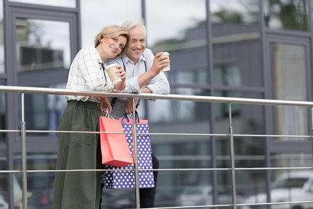 Wife and husband drinking coffee after shopping Stock Photo