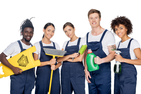 group of young multiethnic cleaners with various cleaning supplies isolated on white Banco de Imagens