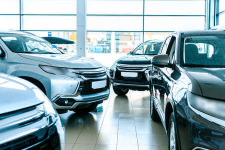 New cars for sale in car showroom Stock Photo