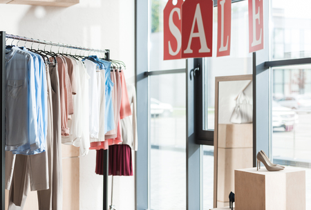Sale in womens and mens clothes shop Stock Photo