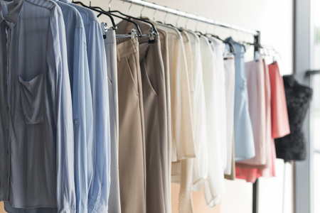Close up view of Rack with womens and mens clothes in a store Stock Photo
