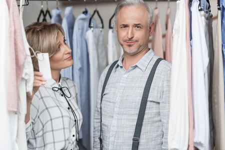 Woman showing a tag to man at the store