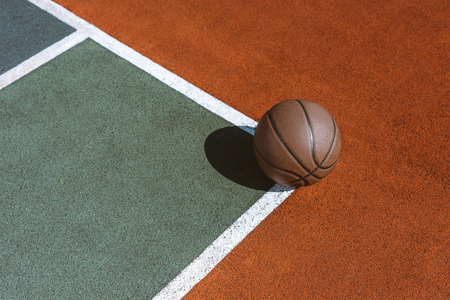 Basketball ball on the ground at sports field Stock Photo